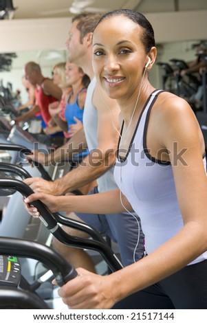 Woman Running On Treadmill At Gym - stock photo