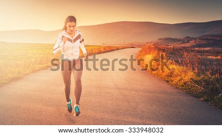 Woman running outdoors in beautiful nature