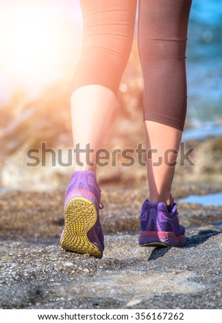 woman running sport feet on trail healthy lifestyle fitness - stock photo