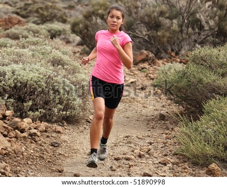 Woman running. Woman trail running outdoors on dirt single track in desert landscape in cross country running shoes. - stock photo