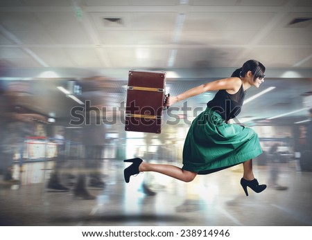 Woman runs late to the flight departure - stock photo