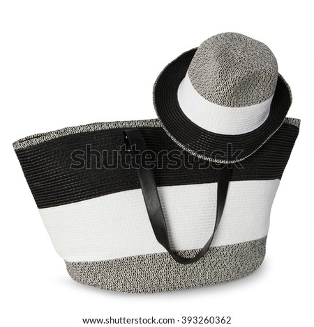 woman's beach set, black and white bag with hat on white background - stock photo