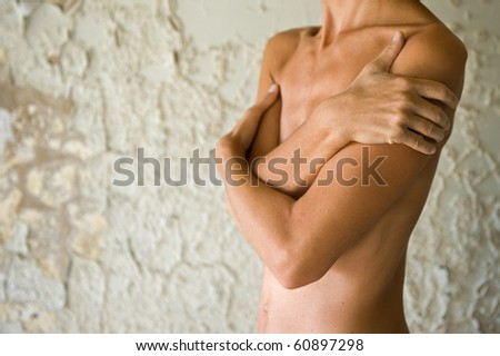 Woman's body on grunge wall. - stock photo