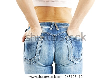 Woman's butt in slim fit jeans. Isolated on white background