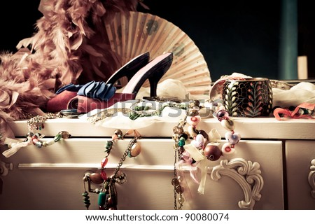 woman's dressing table with lot of fashion accessories - stock photo