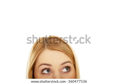 Woman's eyes looking up. - stock photo