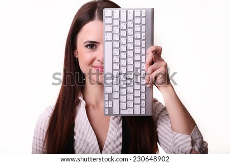 Woman's face covered keyboard isolated on white  - stock photo