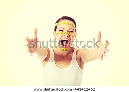 Woman's face with measuring tape