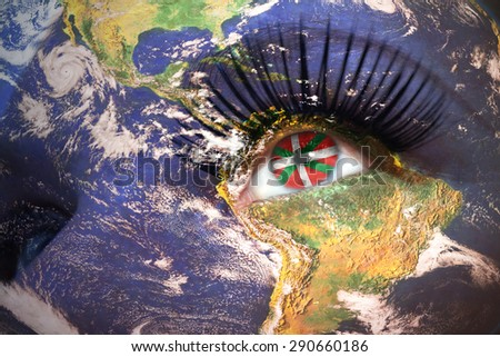 woman's face with planet Earth texture and basque country flag inside the eye. Elements of this image furnished by NASA. - stock photo