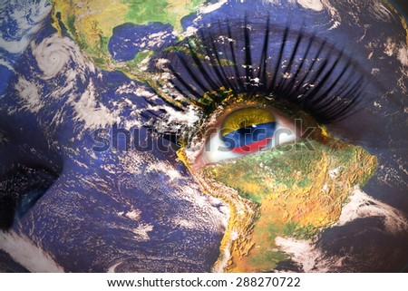 woman's  face with planet Earth texture and colombian flag inside the eye. Elements of this image furnished by NASA. - stock photo