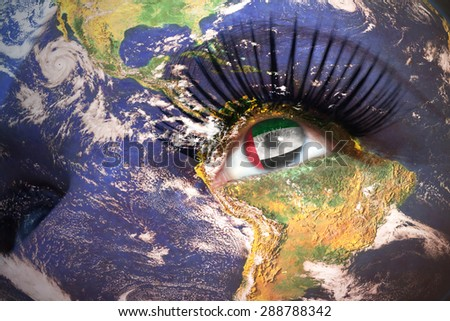 woman's face with planet Earth texture and united arab emirates flag inside the eye. Elements of this image furnished by NASA. - stock photo