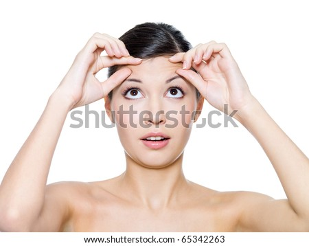 Woman's face with the wrinkles on her forehead - isolated on white - stock photo