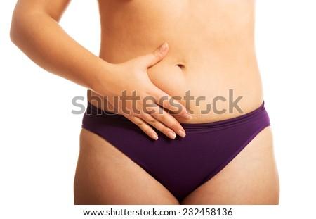 Woman's fat belly in underwear. - stock photo