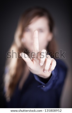 Woman's hand and one finger pointing something - stock photo