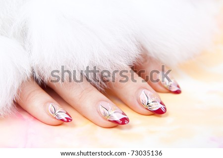 Woman's hand at the tissue background with fur - stock photo