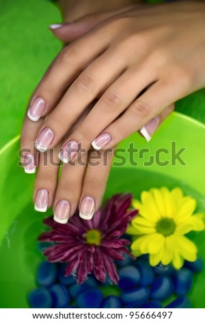 Woman's hand care with bath - stock photo