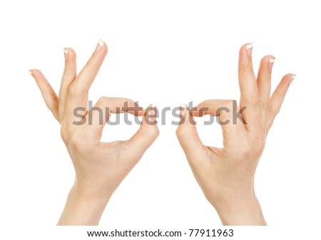 Woman's hand close-up shows a gesture ok is isolated on a white background. - stock photo