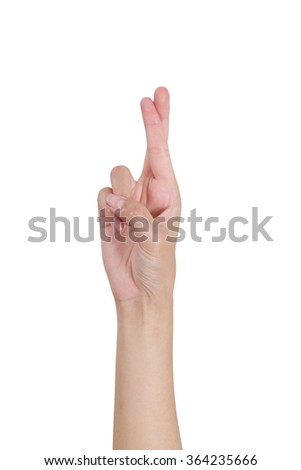 Woman's hand gesturing crossed fingers front side, Isolated on white background.