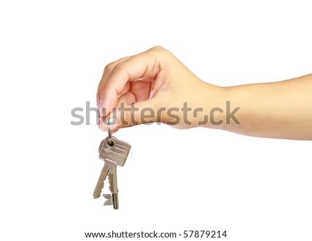 Woman's hand giving keys - stock photo