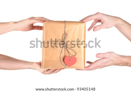 Woman's hand giving parcel with blank heart-shaped label to man isolated on white - stock photo
