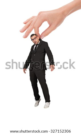 Woman's hand holding a businessman over white background. Man in glasses looking so surprised and astonished.