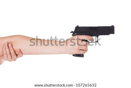 Woman's hand holding a gun isolated on white
