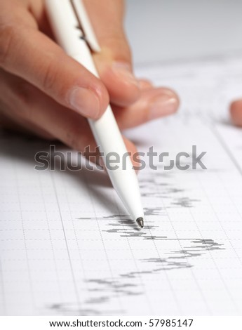 woman?s hand holding a pen - stock photo