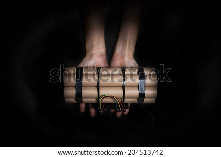 woman's hand holding Bomb with clock timer - stock photo