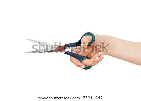 woman's hand holding the scissors on a white background - stock photo