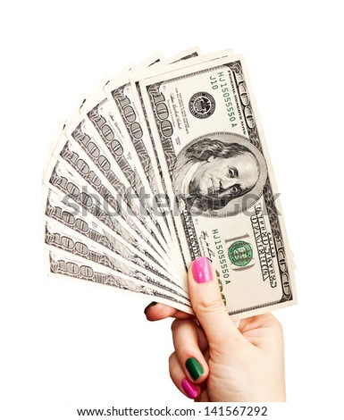 Woman's hand holding 100 US dollar banknotes, isolated on white background