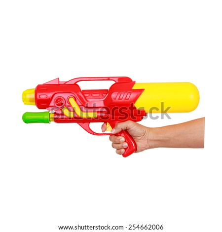 Woman's hand holding water gun isolated on white background. - stock photo