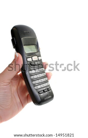 woman's hand holds or answers  portable handset telephone