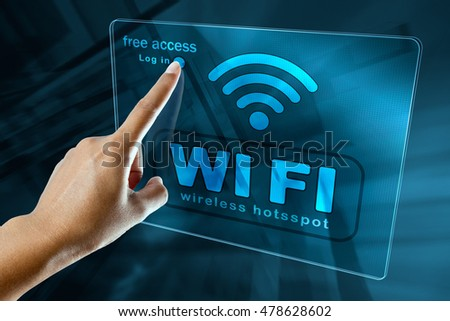 Woman's Hand log in to a free wifi zone, wi-fi concept