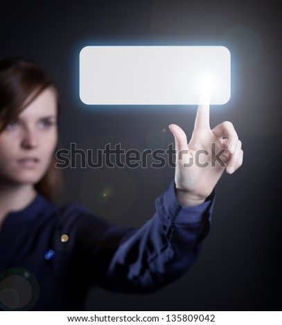 Woman's hand pushing the button on touch screen - stock photo