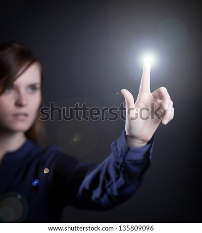 Woman's hand pushing the button on virtual touch screen - stock photo