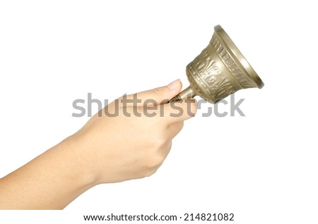 Woman's hand ringing hand bell isolate on white background - stock photo