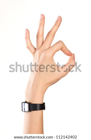 woman's hand showing ok symbol - stock photo