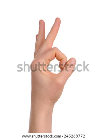 woman's hand showing okay sign isolated over white - stock photo