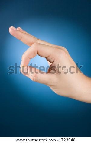 woman's hand shows exact/correct - stock photo