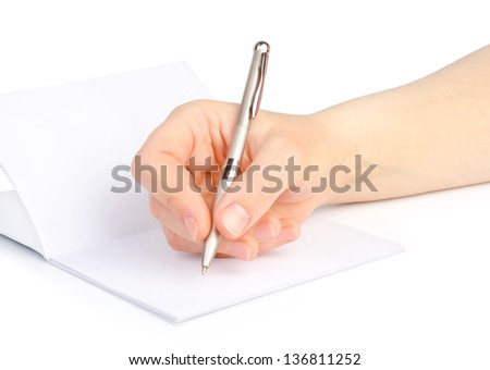 Woman's hand with a pen writes in a notebook.