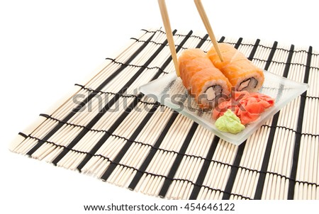 Woman's hand with chopsticks and maki sushi isolated on white - stock photo