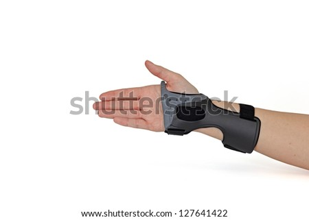 Woman's hand with orthosis isolated on white. - stock photo