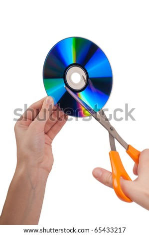 Woman`s hands cutting disc with scissors isolated on white background - stock photo