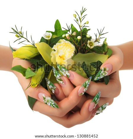 Woman's hands holding a bouquet of flowers. - stock photo