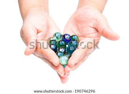 Woman's hands holding a crystal ball. - stock photo