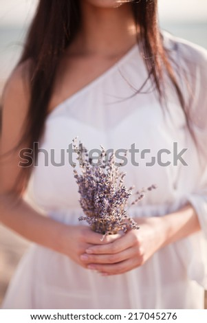 Woman's hands holding bouquet of lavender - stock photo