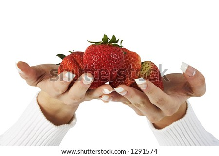 Woman's hands holding fresh strawberries over white. Clipping path.