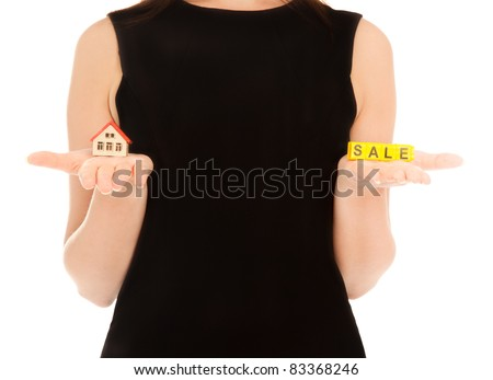 Woman's hands holding house and keys isolated on white