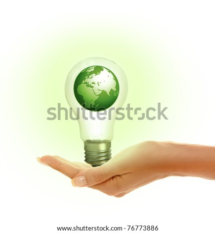woman's hands holding shiny lamp - stock photo