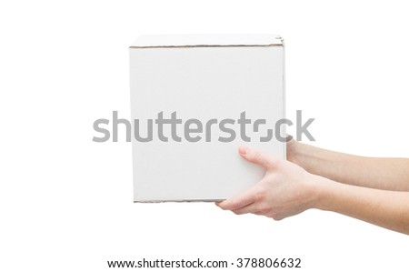 Woman's hands holding white box - stock photo